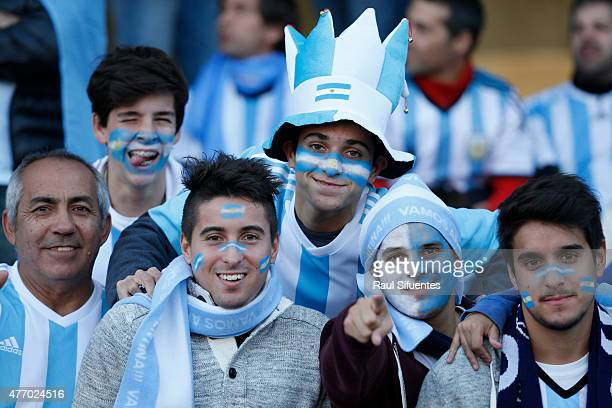 Fans of Argentina stare at camera for press prior the 2015 Copa America Chile Group B match between Argentina and Paraguay at La Portada Stadium on...