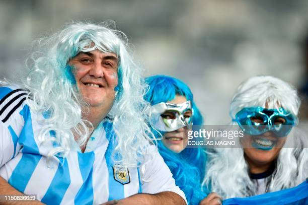 Fans of Argentina wait for the start of the Copa America football tournament group match against Paraguay at the Mineirao Stadium in Belo Horizonte,...