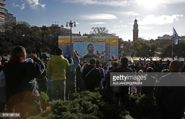 Fans of Argentina watch the FIFA World Cup Russia 2018 match between Argentina and Iceland on a large screen at San Martin square in Buenos Aires on...