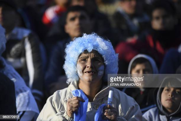 Fans of Argentina watch the FIFA World Cup Russia 2018 match between Argentina and Croatia on a giant screen at San Martin square in Buenos Aires on...