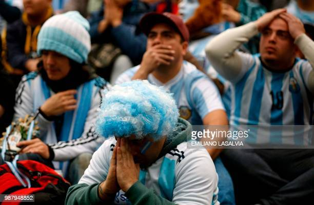 Fans of Argentina watch the FIFA World Cup Russia 2018 match between Argentina and France on a giant screen at San Martin square in Buenos Aires on...