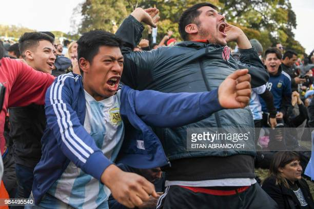 Fans of Argentina watching the FIFA World Cup match against Nigeria on a large screen at San Martin square in Buenos Aires celebrate after Argentine...