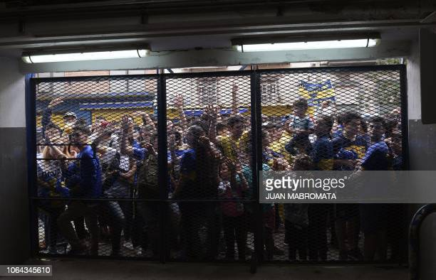 TOPSHOT Fans of Argentina's Boca Juniors gather outside the La Bombonera stadium in Buenos Aires hoping to get in to watch an open training session...