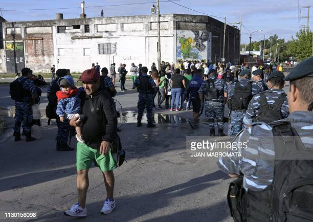 Fans of Argentina's Defensa y Justicia football team arrive at the 'Norberto Tomaghello' stadium to attend the Argentine Superliga football match...