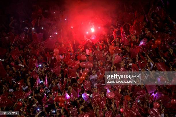 Fans of Argentina's Independiente cheer before the Copa Sudamericana second leg semifinal football match against Paraguay's Libertad at Libertadores...