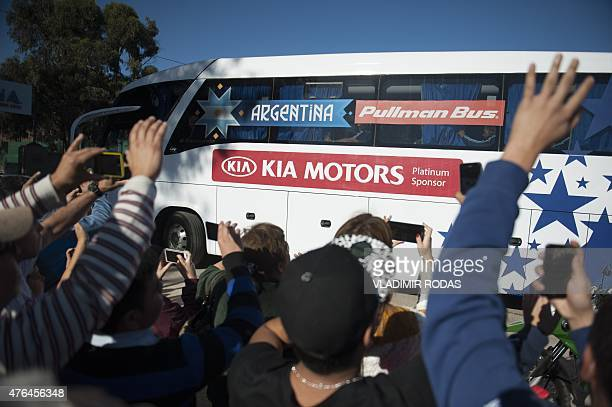 Fans of Argentina's national football team wave upon the latter's arrival at La Alpina training camp in La Serena on June 9 2015 The Copa America...