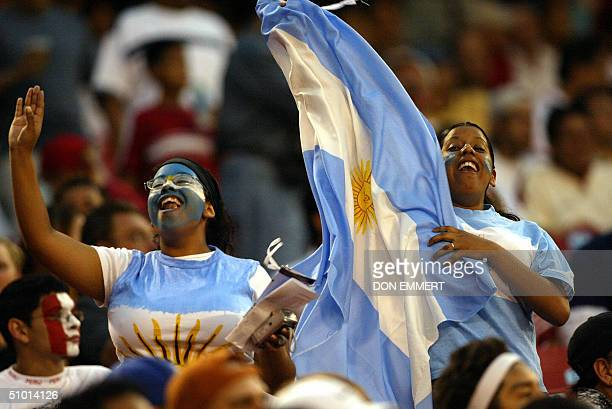 Fans of Argentina's National soccer team cheer prior to their friendly match against Peru 30 June 2004 at Giants Stadium in East Rutherford NJ AFP...