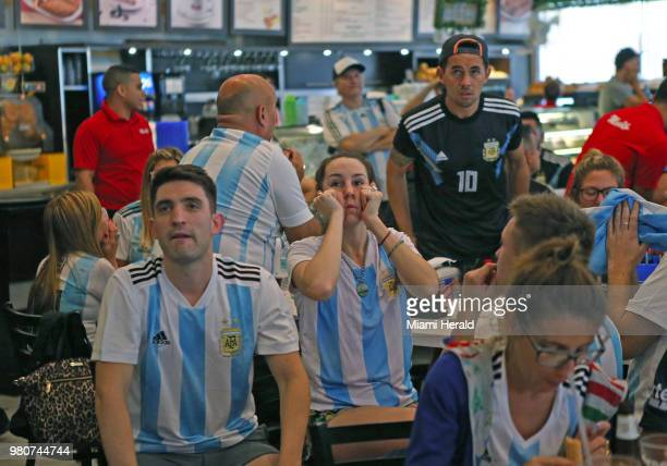 Fans of Argentina's national soccer team react after Croatia scores the third goal as they watch a television broadcast of the Russia 2018 World Cup...