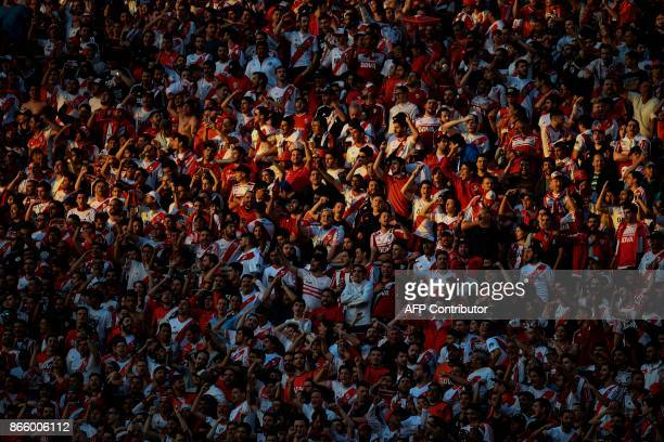 Fans of Argentina's River Plate cheer for their team during the Copa Libertadores semifinal first leg football match against Argentina's Lanus at the...