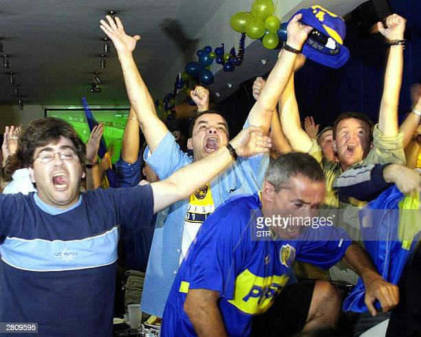 Fans of Argentine football team Boca Juniors celebrate its victory over the AC Milan in the the game for the Intercontinental Cup played in Japan 14...