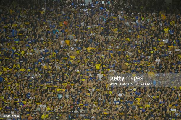 Fans of Argentine team Boca Juniors cheer before the start of the Argentina First Division Superliga football match against Tigre at the Alberto J...