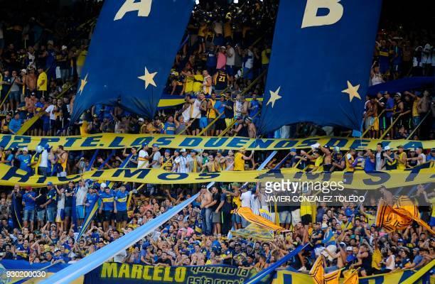 Fans of Argentine team Boca Juniors cheer during the Argentina First Division Superliga football match against Tigre at the Alberto J Armando 'La...