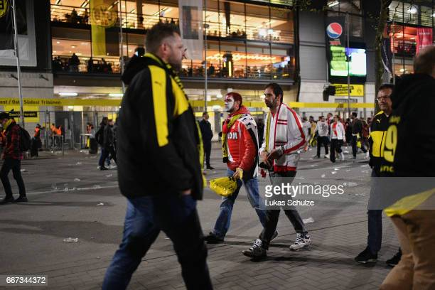 Fans of AS Monaco leave the Signal Iduna Park area after the match between Borussia Dortmund and AS Monaco was cancelled after the team bus of the...