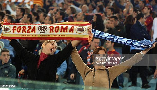 Fans of AS Roma and Lazio Rome wave their banners during the Italian First League derby AS Roma vs Lazio Rome 27 October 2001 at Rome's Olympic...