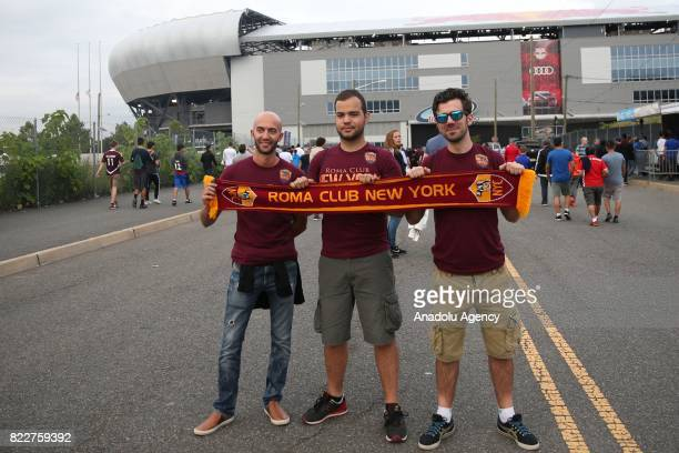 Fans of AS Roma pose for a photo with a scarf ahead of International Champions Cup 2017 friendly match between Roma and Tottenham at Redbull Arena...