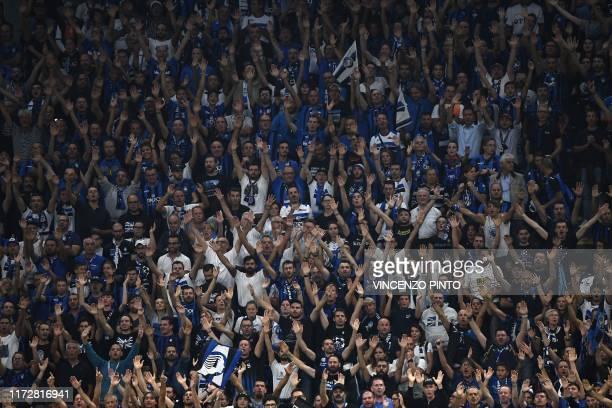 Fans of Atalanta cheer during the UEFA Champions League Group C stage football match Atalanta Bergamo vs Shakhtar Donetsk on October 1 2019 at San...