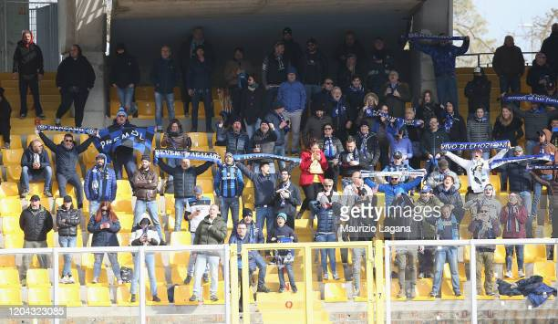 Fans of Atalanta cheer for their team during the Serie A match between US Lecce and Atalanta BC at Stadio Via del Mare on March 1 2020 in Lecce Italy