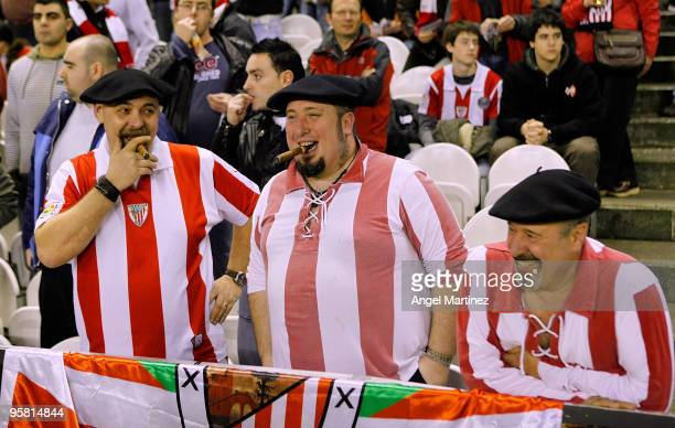 Fans of Athletic Bilbao smile as they smoke cigars prior the La Liga match between Athletic Bilbao and Real Madrid at the San Mames stadium on...