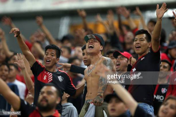 Fans of Atlas cheer during a Group F match between Atlas and Cruz Azul as part of Torneo Apertura Copa MX 2018 at Estadio Jalisco on August 29, 2018...
