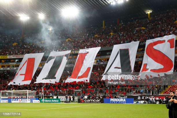 Fans of Atlas show giant letters to spell Atlas during the 9th round match between Atlas and Chivas as part of the Torneo Clausura 2020 Liga MX at...