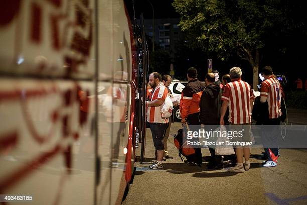 Fans of Atletico de Madrid queue to enter their coach to Lisbon outside Vicente Calderon Stadium a day before the UEFA Champions league Final of Real...