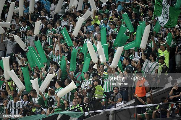 Fans of Atletico Nacional cheer for their team during a group stage match between Atletico Nacional and Sporting Cristal as part of Copa Libertadores...