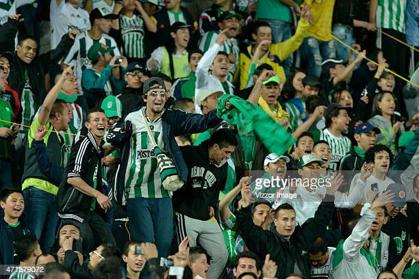 Fans of Atletico Nacional cheer for their team during a match between La Equidad and Atletico Nacional as part of ninth round of Liga Aguila I 2015...