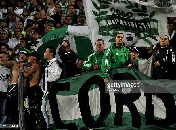 Fans of Atletico Nacional cheer for their team during a second leg match between Atletico Nacional and Huracan as part of round of 16 of Copa...
