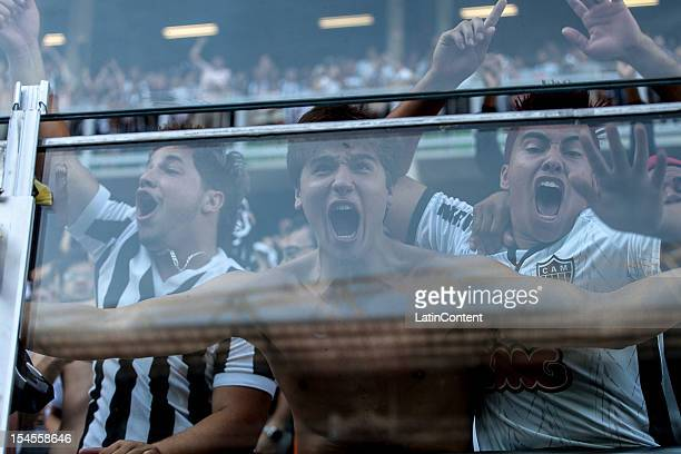 Fans of Atlético MG celebrate a goal during a match between Atlético MG and Fluminense as part of Campeonato Brasileiro 2012 at Estádio Independencia...