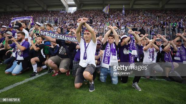 Fans of Aue celebrate after their team won the 2 Bundesliga Playoff Leg 2 match between Erzgebirge Aue and Karlsruher SC at...