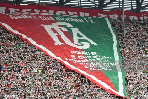 Fans of Augsburg hold up scarfs prior to the Bundesliga match between FC Augsburg and RB Leipzig at WWK-Arena on October 20, 2018 in Augsburg,...