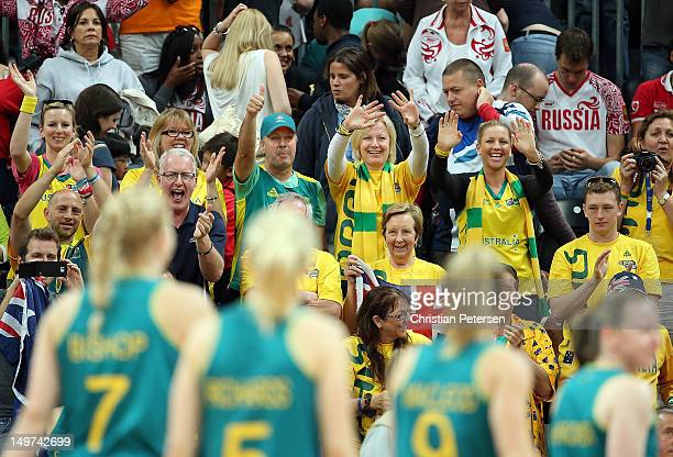 Fans of Australia wave to players as they leave the court after defeating Russia in the Women's Basketball Preliminary Round match on Day 7 of the...