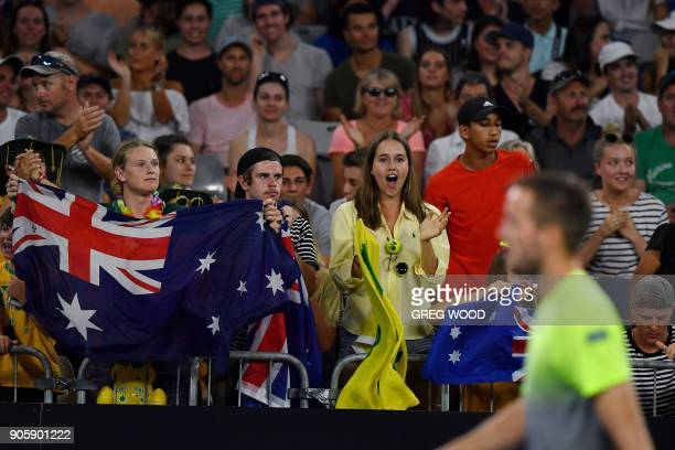 Fans of Australia's Nick Kyrgios cheer as Serbia's Viktor Troicki walks past during their men's singles second round match on day three of the...