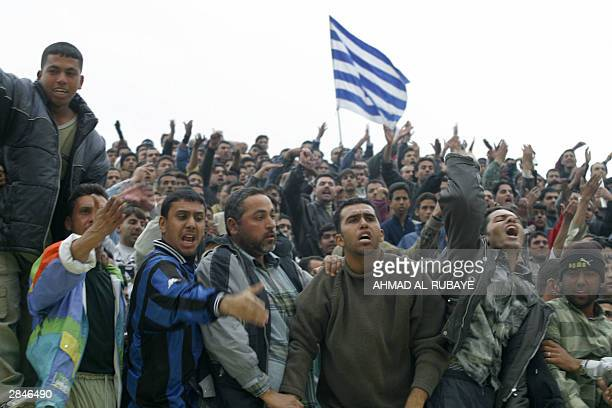 Fans of Baghdad club alTalaba heckle the referee during the final against rival Baghdad team alZawra of the Baghdad Cup the first national soccer...