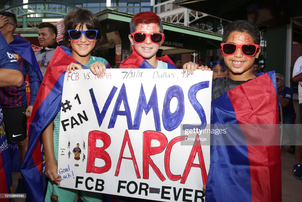 Fans of Barcelona pose for a photo at the Texas Rangers stadium before the game between FC Barcelona and AS Roma as part of International Champions Cup 2018 at AT&T Stadium on July 31, 2018 in Arlington, Texas.