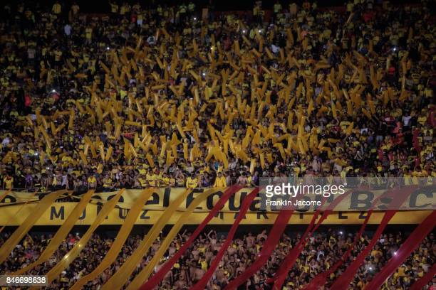Fans of Barcelona SC cheer their team during a first leg match between Barcelona SC and Santos as part of quarter finals of Copa CONMEBOL...