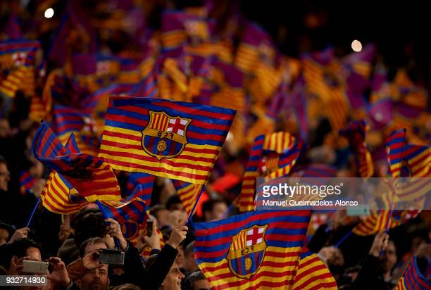 Fans of Barcelona wave flags prior to the UEFA Champions League Round of 16 Second Leg match between FC Barcelona and Chelsea FC at Camp Nou on March...
