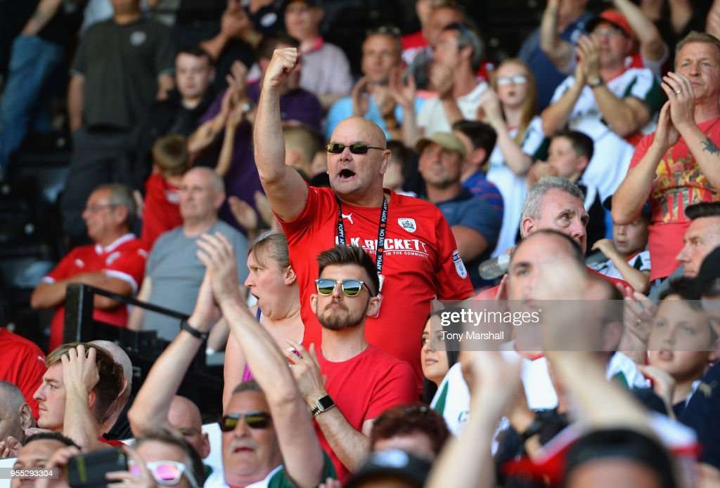 Fans of Barnsley show their support for their team as they are relegated during the Sky Bet Championship match between Derby County and Barnsley at iPro Stadium on May 6, 2018 in Derby, England.