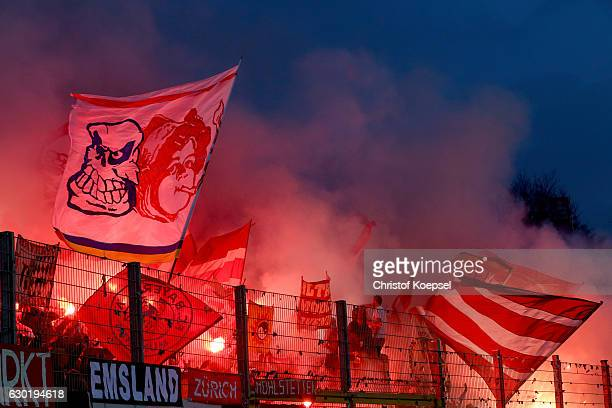 Fans of Bayern fire smoke bombs during the Bundesliga match between SV Darmstadt 98 and Bayern Muenchen at Stadion am Boellenfalltor on December 18...
