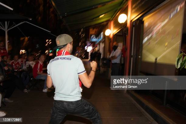 Fans of Bayern Muenchen attend the public viewing of the UEFA Champions League Final 2020 between Paris Saint-Germain and FC Bayern Muenchen at...