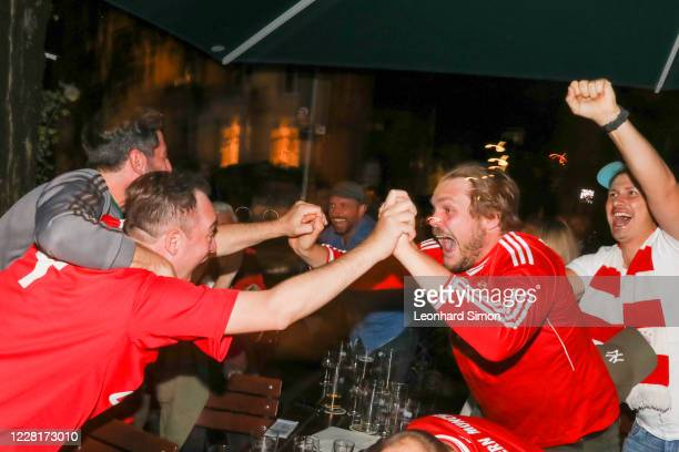 Fans of Bayern Muenchen celebrate FC Bayern Munich's first goal during of the UEFA Champions League Final 2020 between Paris Saint-Germain and FC...