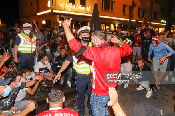 Fans of Bayern Muenchen celebrate FC Bayern Munich's victory in the UEFA Champions League Final 2020 between Paris Saint-Germain and FC Bayern...