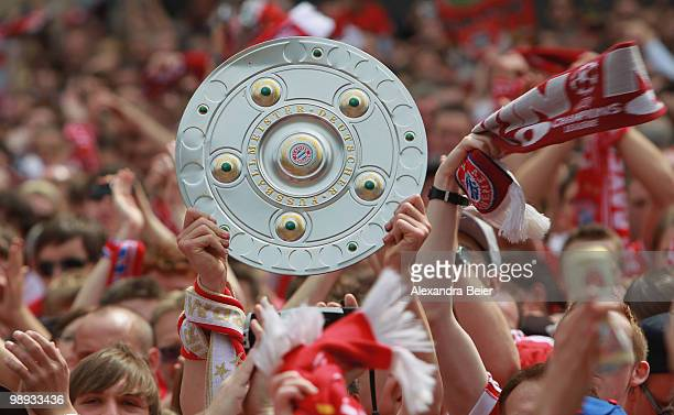 Fans of Bayern Muenchen celebrate their team's German championship title at the town hall square on May 9 2010 in Munich Germany