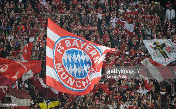 Fans of Bayern Muenchen wave their flags ahead of the UEFA Champions League Quarter Final first leg match between FC Bayern Muenchen and SL Benfica...