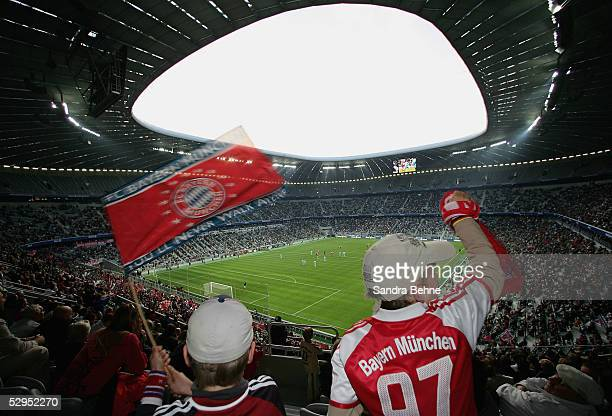 Fans of Bayern Munich cheer during an exhibition match between the traditional teams of 1860 Munich and Bayern Munich at the Allianz Arena on May 19...