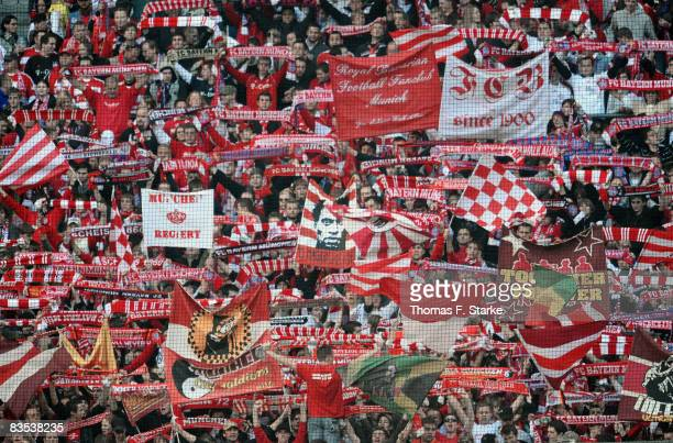Fans of Bayern Munich cheer their team during the Bundesliga match between Bayern Munich and Arminia Bielefeld at the Allianz Arena on November 1...