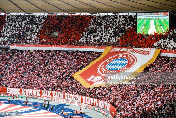 Fans of Bayern Munich show their logo prior to the DFB Cup final between RB Leipzig and Bayern Muenchen at Olympiastadion on May 25 2019 in Berlin...