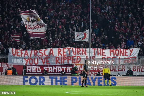 Fans of Bayern Munich shows up a banner during the UEFA Champions League match between Bayern Munich and Paris Saint Germain at Allianz Arena on...