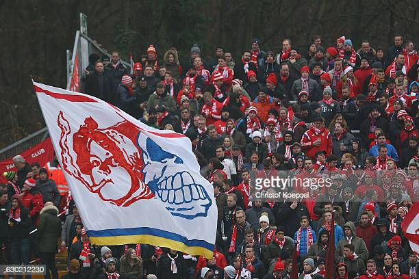 Fans of Bayern wave flags during the Bundesliga match between SV Darmstadt 98 and Bayern Muenchen at Stadion am Boellenfalltor on December 18 2016 in...