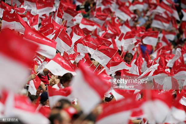 Fans of Bayern wave their flags during the Bundesliga match between FC Bayern Munich and Hertha BSC Berlin at the Allianz Arena on May 17 2008 in...